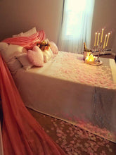 Bed with rose petals and candles
