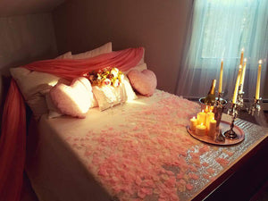 Romantic Bedroom with rose petals, champagne, flowers