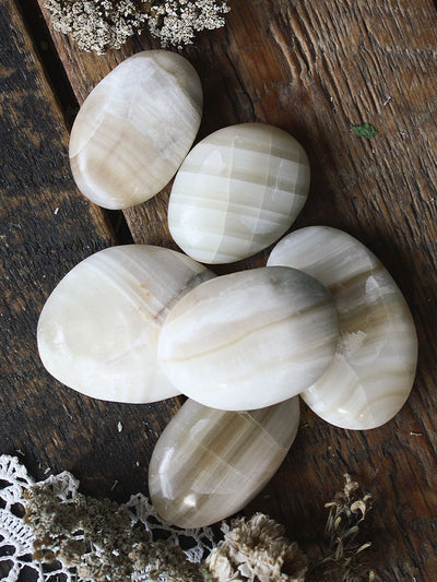 White Aragonite Palm Stones