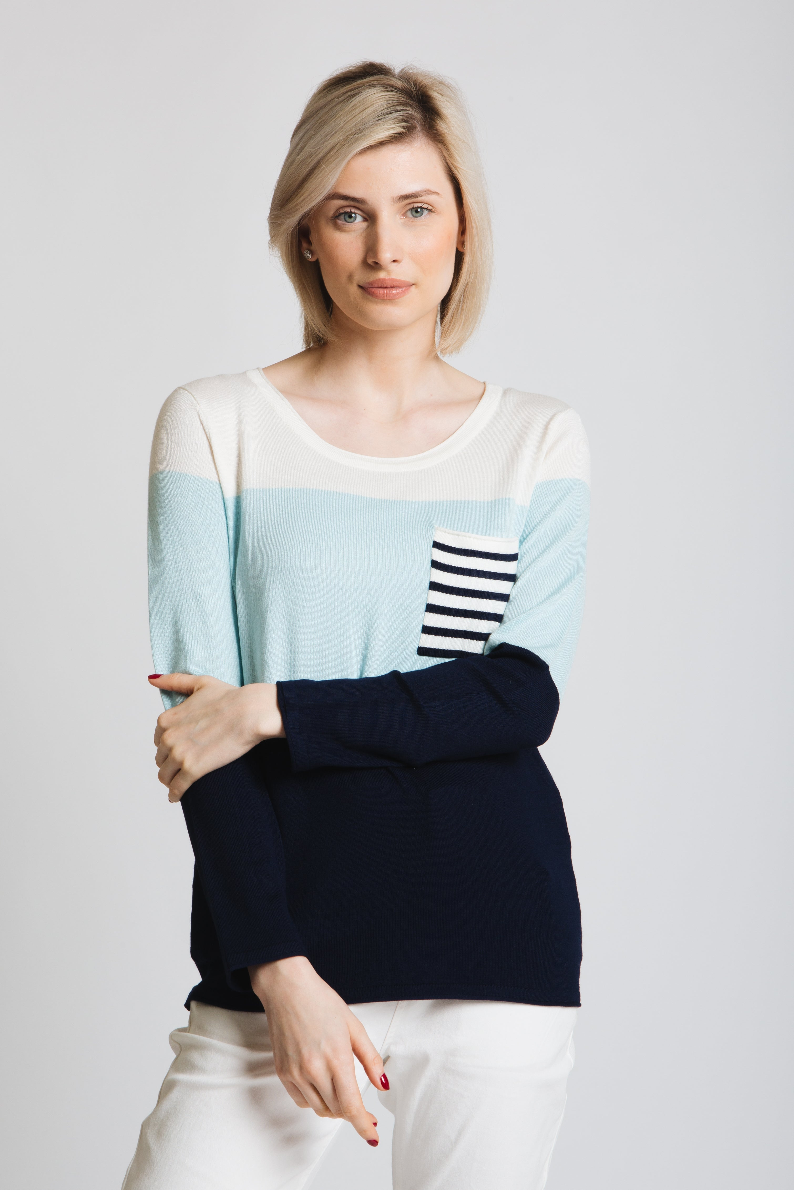 Colour block sweater with mini stripe patch pocket. Scoop neck, log sleeve, classic fit