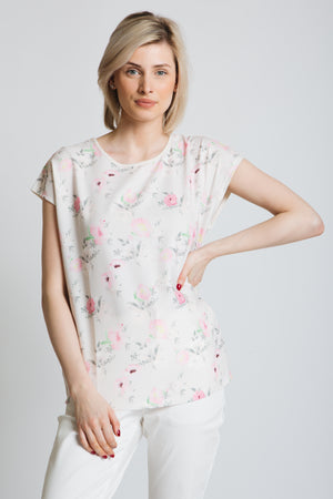Printed woven front top with soft jersey back panel. Round neck, Drop shoulder fit. Exclusive print