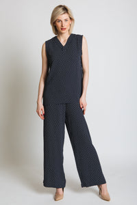 Wide leg, fitted waist with side zip. Gorgeously flowy fabric with a on trend polka dot print.