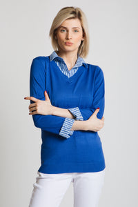 Our classic fit v-neck sweater trimmed with printed fabric collar and cuff. A wardrobe staple!