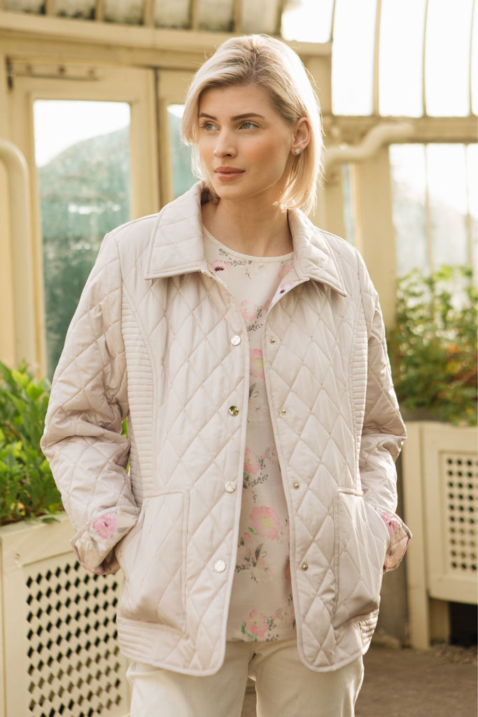 Our best selling classic diamond quilt  jacket in soft neutral stone. floral print lining to match. Standard fit.