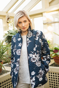 Embossed zig-zag quilt jacket in one of our new summer print, navy base with white floral. A very chic look