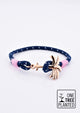 Daybreak - Single - Season two Palm anchor bracelet with pink and blue nylon band.
