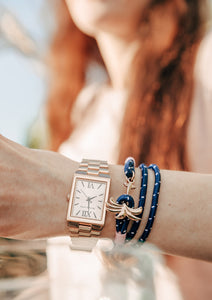 Daybreak - Triple - Season two Palm anchor bracelet with pink and blue nylon band. On models arm.