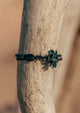 Eclipse - Season two Palm anchor bracelet with black leather. On a tree and closeup.