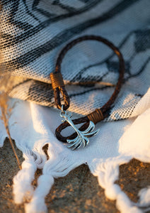 Oakland - Season two Palm anchor bracelet with brown leather. On the beach.