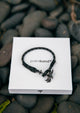 Phantom Black - Single - Season two Palm anchor bracelet with black and grey nylon band. On palm band box.
