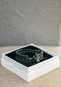 Phantom Black - Triple - Season two Palm anchor bracelet with black and grey nylon band. In the palm band box.