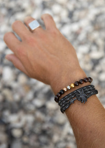Phantom Black - Triple - Season two Palm anchor bracelet with black and grey nylon band. On model hand.