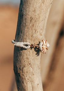 Serene - Season two Palm anchor bracelet with white leather. Close up in nature.