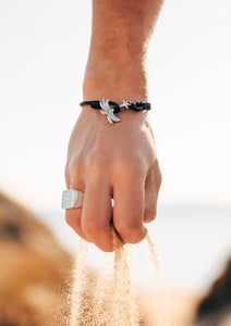 Starlight - Season two Palm anchor bracelet with black leather. On male model.