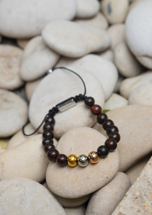 Palm Band - Bead bracelet on rocks.