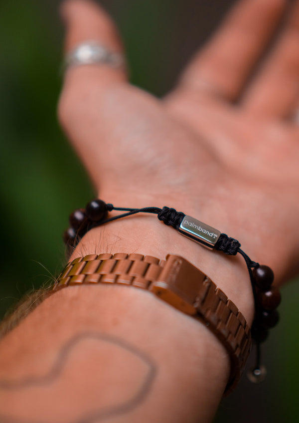 Palm Band - Bead bracelet for season 1 on wrist showing logo.