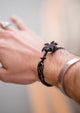 Pitch Black - Palm anchor bracelet with black leather. Lifestyle photo on wrist.