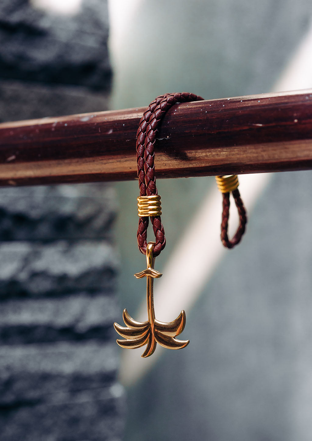 Sunrise Gold - Palm anchor bracelet with brown leather. Lifestyle photo.