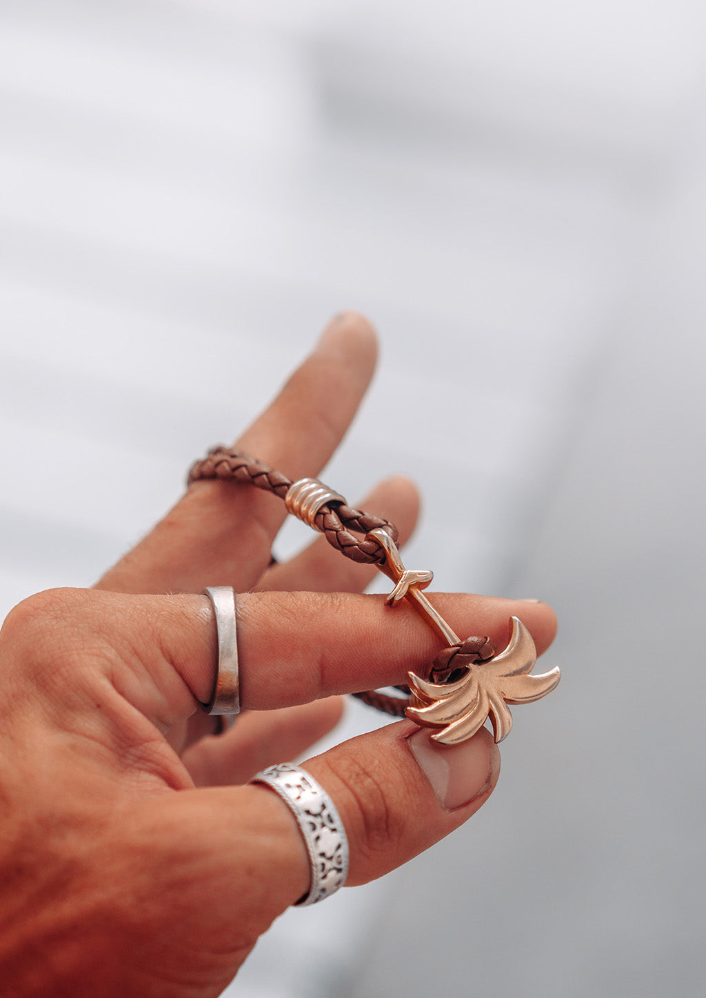 Sunrise Gold - Palm anchor bracelet with brown leather. Lifestyle photo showing off.