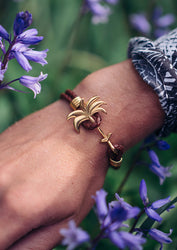 Sunrise Gold - Palm anchor bracelet with brown leather. Lifestyle photo on wrist.