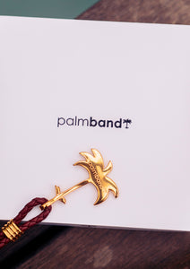 Sunrise Gold - Palm anchor bracelet with brown leather. Lifestyle photo with box.