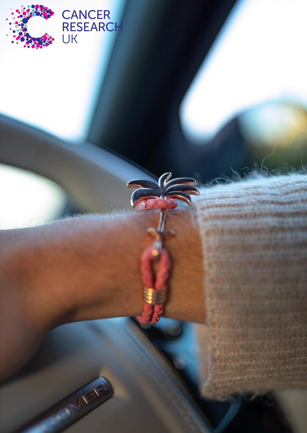 Flamingo Rose - Palm anchor bracelet with pink leather. Lifestyle photo in car.