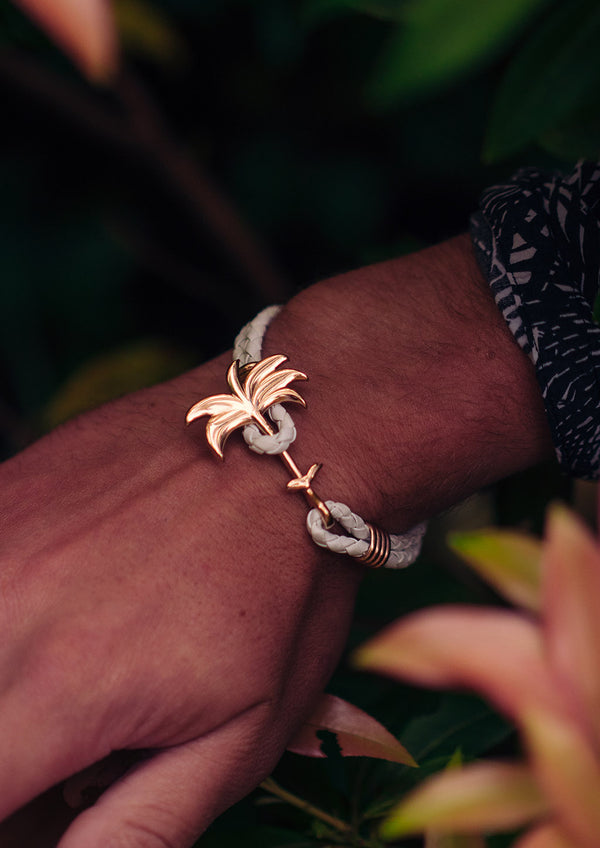 Paradise Rose - Palm anchor bracelet with white leather. Lifestyle photo on wrist.