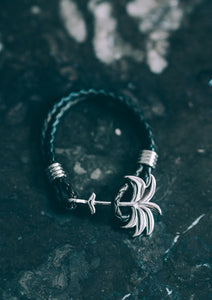 Twilight Silver - Palm anchor bracelet with black leather. Lifestyle photo.
