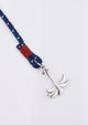 Voyager - Single - Season two Palm anchor bracelet with blue and red nylon band. Close up with details.
