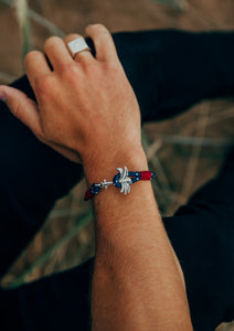 Voyager - Single - Season two Palm anchor bracelet with blue and red nylon band. On models hand.