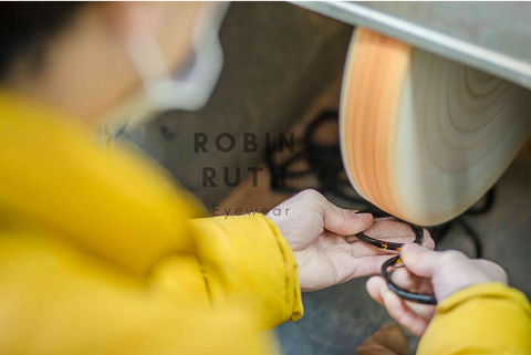 Aisan Man making Robin Ruth Sunglasses in yellow jacket