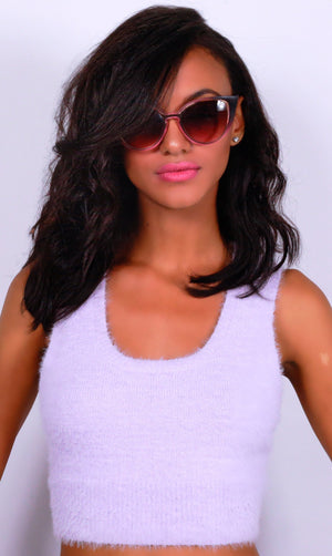 Pretty girl wearing pink shirt and Rima sunnies