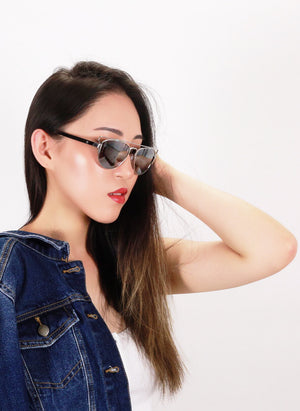 Asian girl with raised arm wears Elenur sunglasses