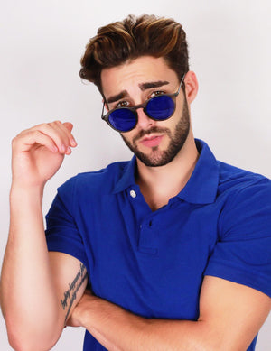 Guy in blue shirt wearing blue lens Robin Ruth Carter sunglasses