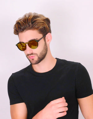 Hungarian man wearing a black shirt and gold Omare sunnies