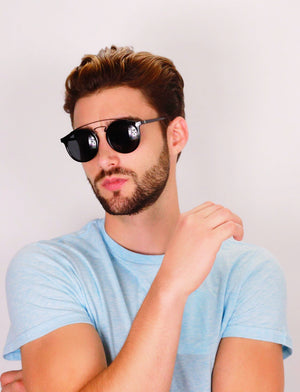 Hungarian dude with crossed arms wears black Kriss sunglasses