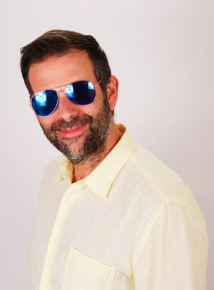 Man with beard wearing blue oak shades