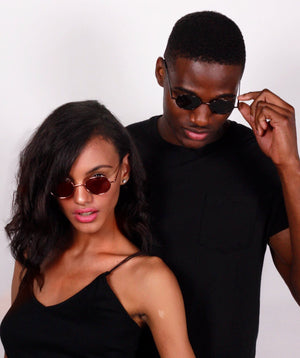 Man and woman wearing all black wearing Robin Ruth Austin Sunnies