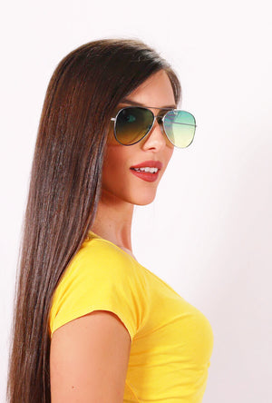 Profile view of girl wearing Green Aguya sunnies