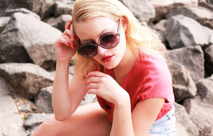 Blonde woman wearing Nureet sunnies