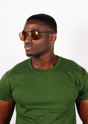 suave black man in green shirt wearing brown princeton Glasses