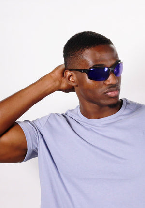 cool black guy wearing blue lens Rawling sunglasses