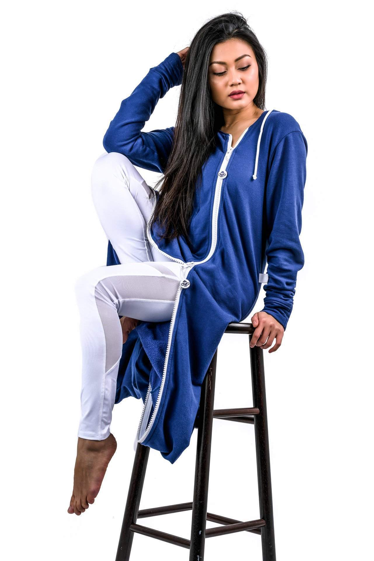 Model Sitting on Chair - rev'pod™ | ultra-soft travel + loungewear | #revpod