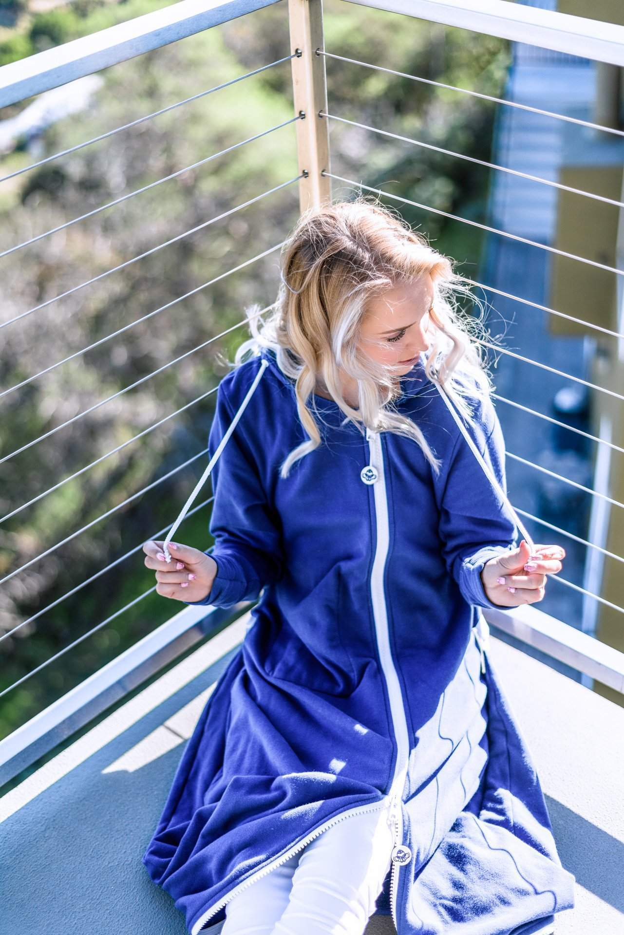 Girl on Balcony in Sunshine - rev'pod™ | ultra-soft travel + loungewear | #revpod