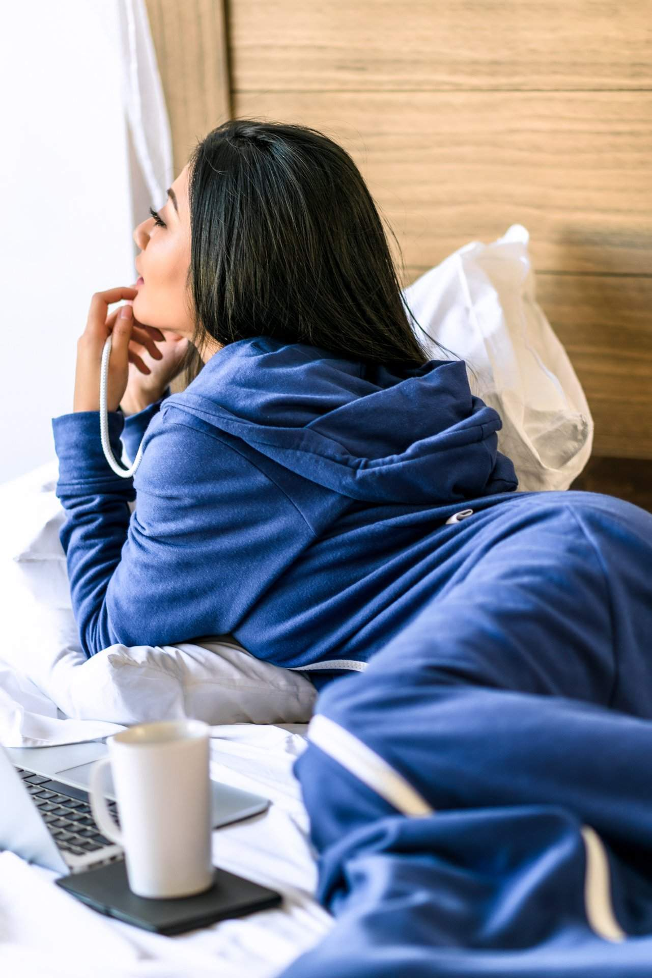 Girl Cozy on Bed with Coffee - rev'pod™ | ultra-soft travel + loungewear | #revpod