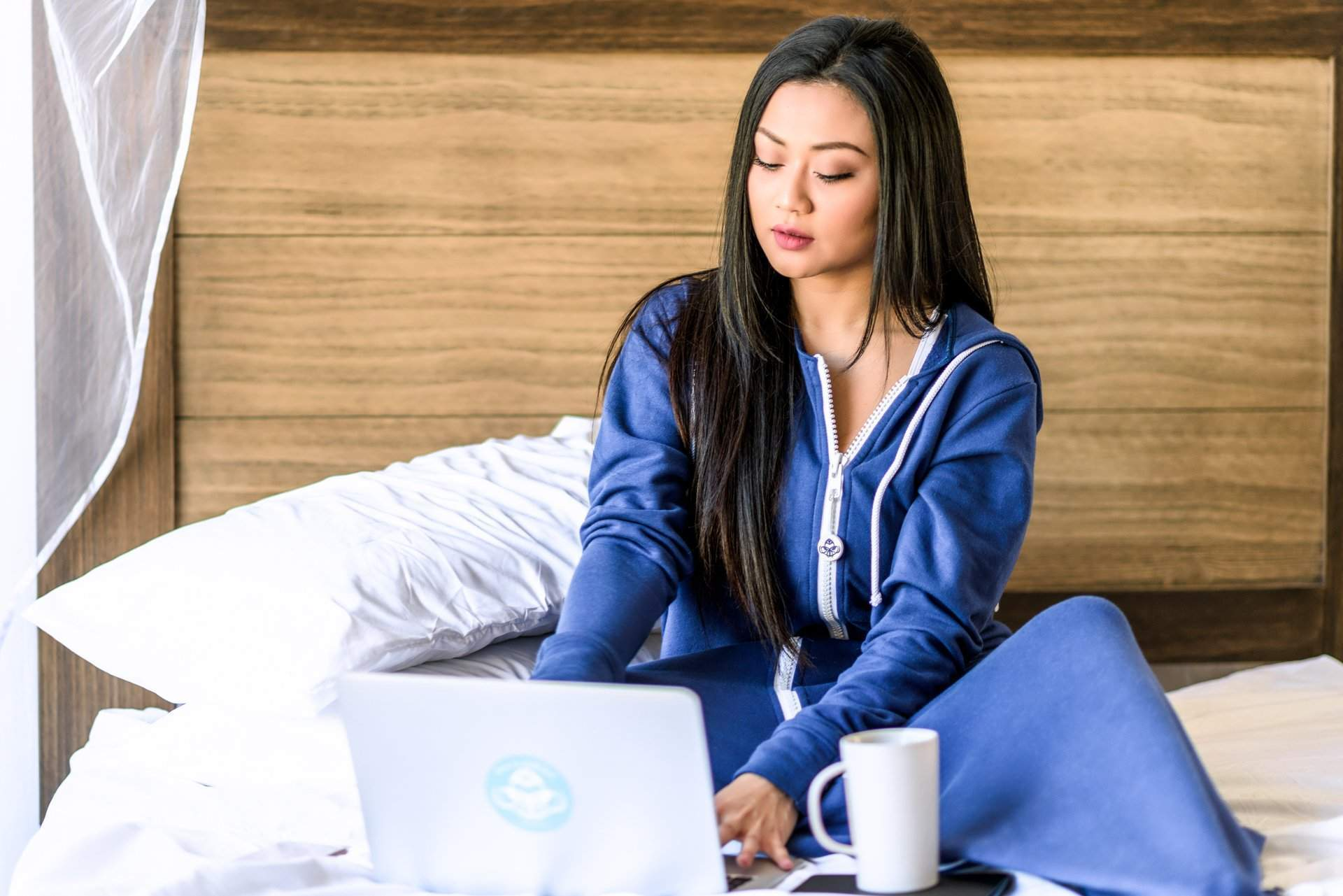 Girl on Comfy Bed Lounging with Laptop - rev'pod™ | ultra-soft travel + loungewear | #revpod