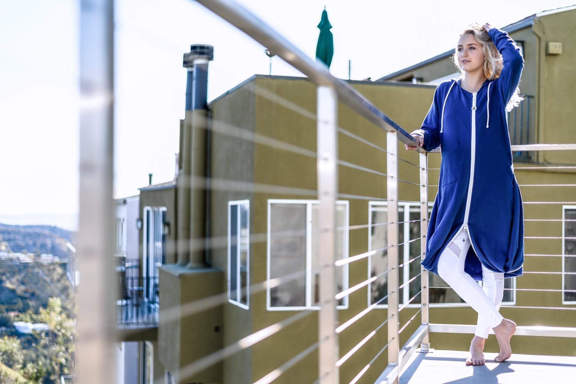 Blonde Model on Balcony Sunshine - rev'pod™ | ultra-soft travel + loungewear | #revpod