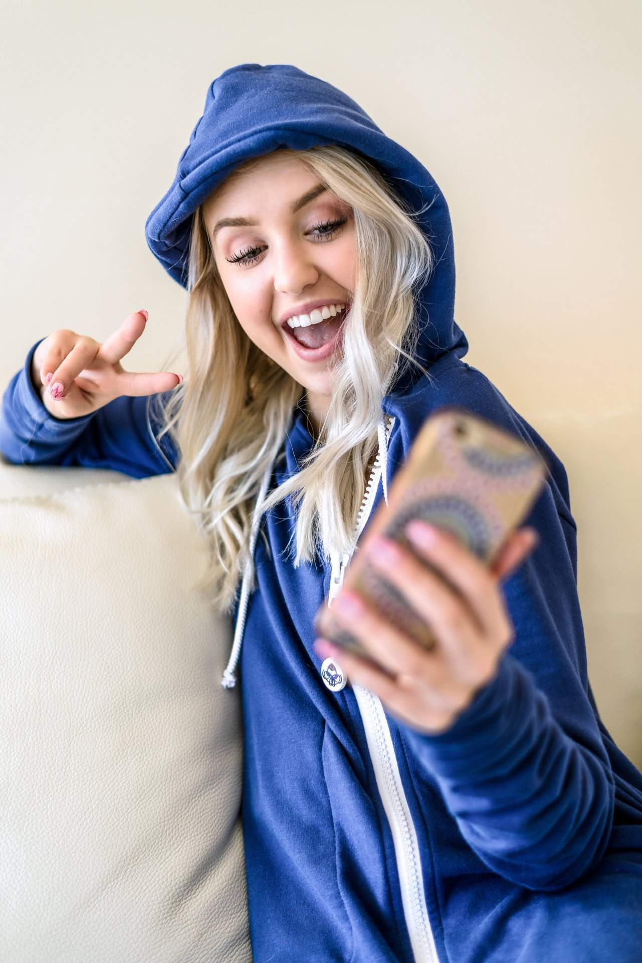 Blonde Girl Selfie iPhone - rev'pod™ | ultra-soft travel + loungewear | #revpod