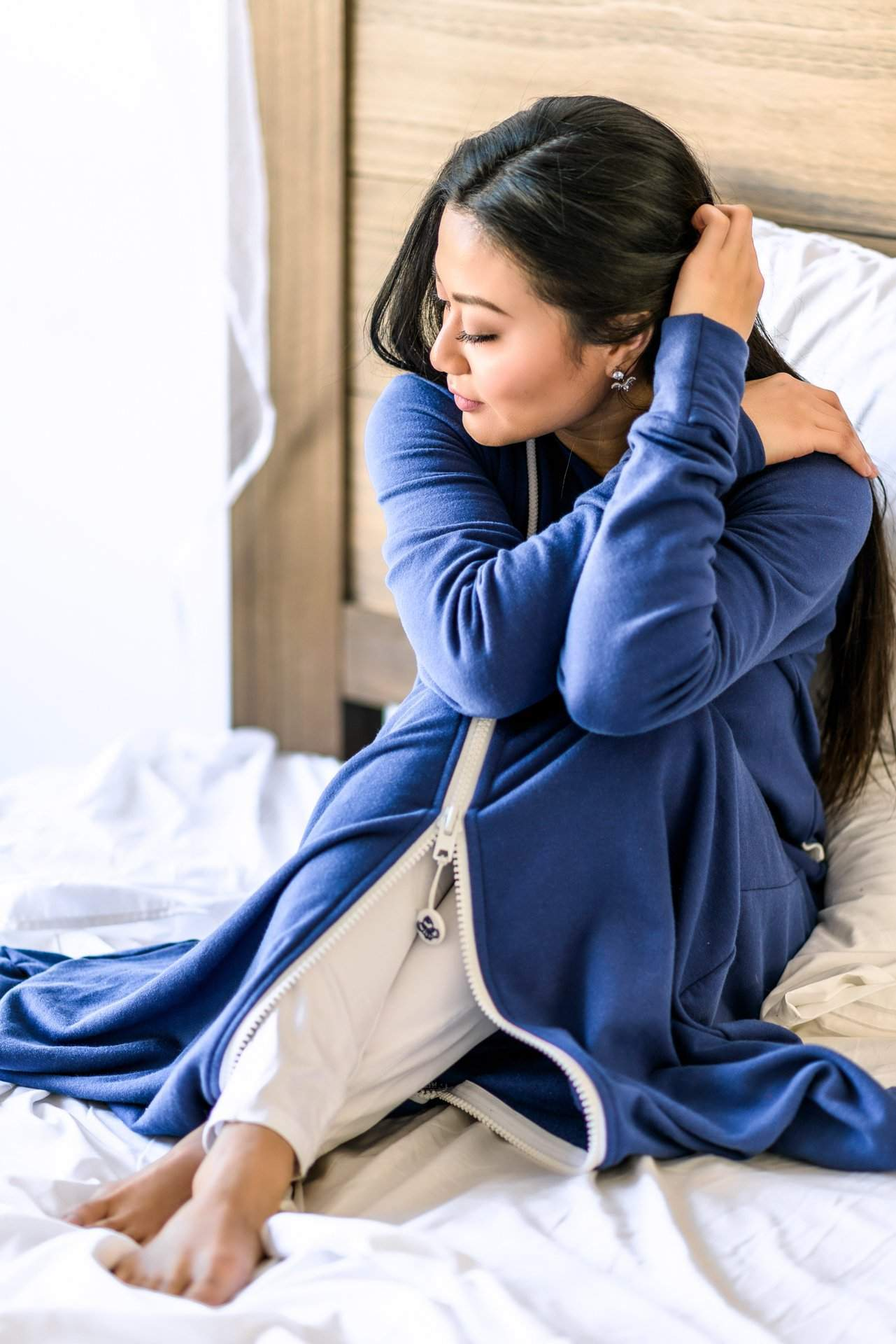 Girl Cozy on Bed - rev'pod™ | ultra-soft travel + loungewear | #revpod