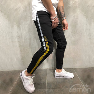 Black Jeans Yellow/White Side Lines